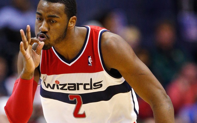 WASHINGTON, DC - MARCH 15: John Wall #2 of the Washington Wizards celebrates after hitting a three pointer against the New Orleans Hornets during the first half at Verizon Center on March 15, 2013 in Washington, DC. NOTE TO USER: User expressly acknowledges and agrees that, by downloading and or using this photograph, User is consenting to the terms and conditions of the Getty Images License Agreement. (Photo by Rob Carr/Getty Images)