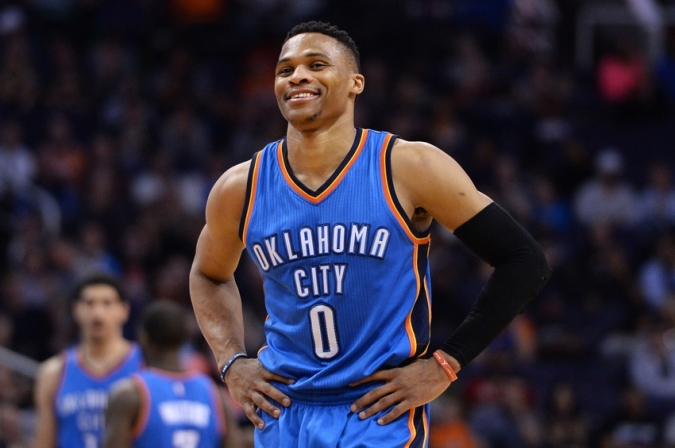 Feb 8, 2016; Phoenix, AZ, USA; Oklahoma City Thunder guard Russell Westbrook (0) smiles on the court in the game against the Phoenix Suns at Talking Stick Resort Arena. Oklahoma City won 122- 106. Mandatory Credit: Jennifer Stewart-USA TODAY Sports