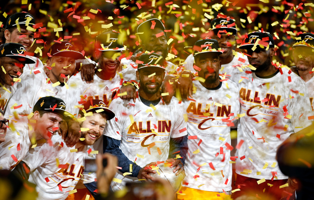 CLEVELAND, OH - MAY 26: The Cleveland Cavaliers celebrate after defeating the Atlanta Hawks during Game Four of the Eastern Conference Finals of the 2015 NBA Playoffs at Quicken Loans Arena on May 26, 2015 in Cleveland, Ohio. NOTE TO USER: User expressly acknowledges and agrees that, by downloading and or using this Photograph, user is consenting to the terms and conditions of the Getty Images License Agreement. (Photo by Gregory Shamus/Getty Images)