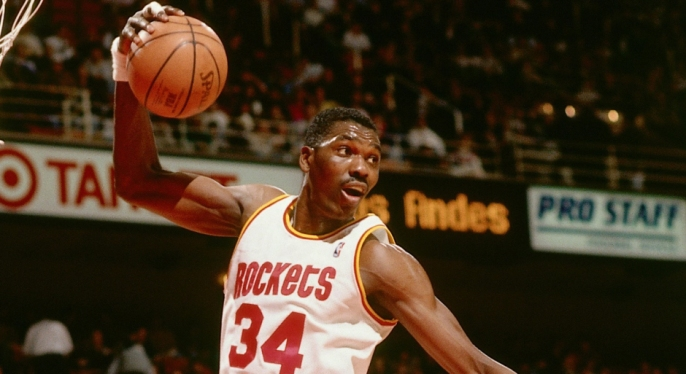 HOUSTON - 1994: Hakeem Olajuwon #34 of the Houston Rockets grabs a rebound against the Boston Celtics during an NBA game at the Compaq Center circa 1994 in Houston, Texas. NOTE TO USER: User expressly acknowledges and agrees that, by downloading and/or using this Photograph, User is consenting to the terms and conditions of the Getty Images License Agreement. Mandatory Copyright Notice: Copyright 1994 NBAE (Photo by Bill Baptist/NBAE via Getty Images)